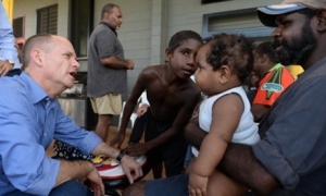 Campbell Newman talks to a local resident at an evacuation centre in the Indigenous community of Hope Vale, 70 kilometres north of Cooktown, on Sunday. Photograph: Dan Peled/AAP