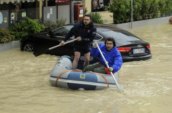 In the port town of Senigallia, streets were submerged and cars were seen floating in filthy water [EPA]
