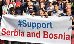 """Novak Djokovic (4-R) poses for a photo with a banner reading """"#support Serbia and Bosnia"""""""