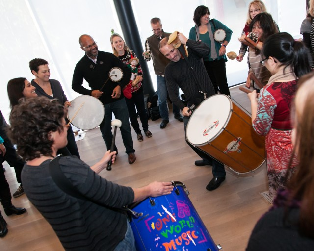 Above: Participants at HopeLab take part in One World Music's Navigating the Rhythms of Change Workshop as a part of its staff development day.  Photo credit: Tracy Wong - See more at: http://www.oneworldmusic.com/blog/?p=522#sthash.ZKJo7D7s.dpuf