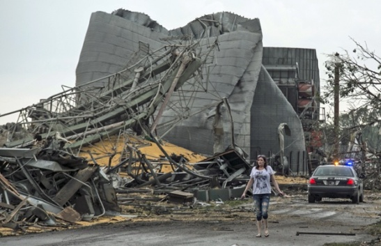 A woman walks along Black Hills Trail in Pilger in the aftermath. Photograph: Mark 'Storm' Farnik/AP