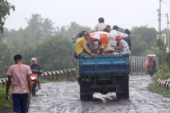 Residents ride on a truck as they are evacuated by authorities from the approaching Typhoon Rammasun in Legazpi City, southeast of Manila.  AFP: Charism Sayat