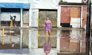 Flooding in Sao Paulo in 2011. Storm-related flooding and poor sanitation have negatively affected its most vulnerable communities. Photograph: Sipa Press / Rex Features