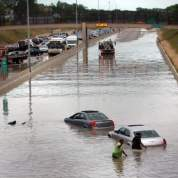 Motorists try to move their cars Thursday after being trapped on the flooded southbound Lodge near Dexter after a water main broke near the freeway about 2:30 p.m. Water from a 42-inch main poured down a freeway ramp and rose nearly 4 feet, causing backups. / Photos by William Archie/Detroit Free Press. Source: http://www.freep.com/article/20120601/NEWS01/206010386/Lodge-reopens-after-flooding-halts-traffic-near-water-main-break
