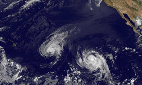 This image provided by NOAA taken Wednesday shows hurricane Iselle, center, and tropical storm Julio, right. Photograph: AP