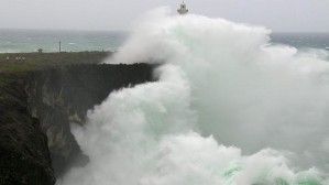Large waves created by Typhoon Vongfong crash into a cliff wall along the coast of Okinawa Photo: AFP