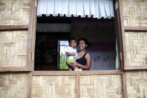 Rachel Cardilo, 26, holds her son in their newly built home... Photo:REUTERS/Thin Lei Win