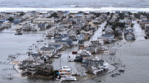 A Portion of Harvey Cedars on Long Beach Island, New Jersey is underwater Tuesday, Oct. 30, 2012, a day after Hurricane Sandy blew across the New Jersey barrier islands. (AP Photo/The Philadelphia Inquirer, Clem Murray)  PHIX OUT; TV OUT; MAGS OUT; NEWARK OUT
