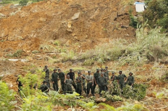 Soldiers wait for instructions before they begin search operations at the Meeriyabedda landslide site in central Sri Lanka. Credit: Contributor/IPS