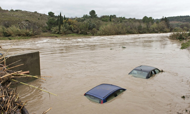 The roofs of flooded cars are seen in the river Berre at Portel les Corbieres, southern France. Photograph: AP  Source: http://www.theguardian.com/world/2014/nov/30/five-dead-thousands-evacuated-severe-southern-france-floods