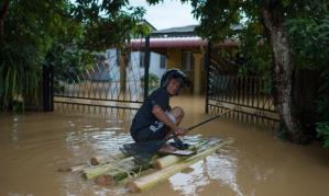 A man makes his way to his house submerged in floodwaters in Pengkalan Chepa, near Kota Bharu. Photograph: MOHD RASFAN/AFP/Getty Images