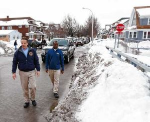 New York Gov. Andrew Cuomo, left, and Buffalo Mayor Byron Brown survey storm clean-up in the south Buffalo area Nov. 23. Cuomo declared a state of emergency when the storm dumped more than six feet of snow on the area. (AP Photo | Mike Groll)