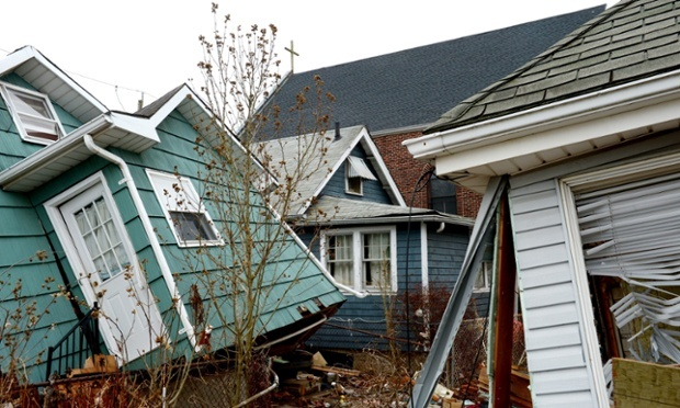 Homes damaged Hurricane Sandy in New Dorp, Staten Island in January 2013 – a month and a half after the storm. How does the money from the federal government trickle down to help these homeowners rebuild – and to prevent this destruction from happening in future storms? Photograph: Justin Lane/EPA