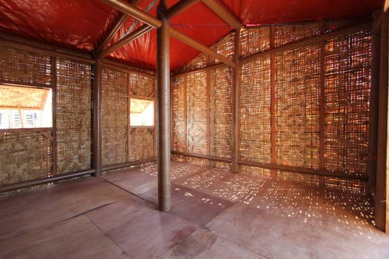 Inside, woven-bamboo siding allows light in and helps wick away water. Ban strengthened the paper-tube structural system he has used in previous disaster shelters, such as the Cardboard Cathedral in Christchurch.