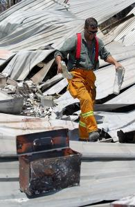 Sifting through the remains ... Ben Whiteway holds the remains of his fire proof safe.His property on Devils Gully Road was destroyed. Source: The Advertiser Source: News Corp Australia
