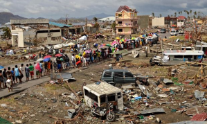 Extreme events displaced 22 million people in 2013, led by Typhoon Haiyan in the Philippines - three times more than the number displaced by conflicts. Photograph: Dondi Tawatao/Getty Images