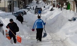 Residents in South Boston dig out their cars following the recent visit of snowstorm Juno. Photograph: CJ Gunther/EPA