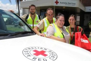 Red Cross Emergency Services Team members prepare to visit Mt Morgan, near Rockhampton. ABC News: Giulio Saggin