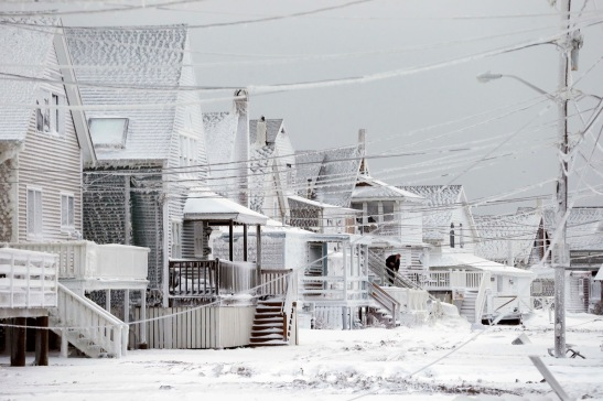 Dexter Newcomb begins cleanup at his house in Scituate, Mass., the day after a winter storm left his neighborhood coated in frozen sea spray and sand. AP Photo/Michael Dwyer Source: http://cdn.flipboard.com/content/thephotodesk/photosoftheweek/items/1422543297000.html