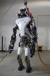 The Defense Advanced Research Projects Agency's Robotics Challenge teams using DARPA's Atlas robot, developed by Boston Dynamics, met in Waltham, Mass., in January to learn about upgrades to the robot. It was redesigned with the goal of improving power efficiency to better support battery operation. About 75 percent of the robot was rebuilt. Only the lower legs and feet were carried over from the original design.