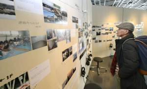 Photos taken by Sendai residents before and after the March 2011 tsunami struck are displayed at Sendai Mediatheque on Tuesday. | KYODO