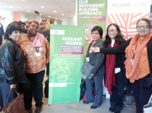 Woman power: Female participants of the World Conference on Disaster Risk Reduction (WCDRR) pose for a photograph in Sendai, Japan, last month. Courtesy of Oxfam