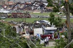 Photo: Volunteers and officials search through the destruction near Van Intermediate School in Texas after a tornado struck the area. (AFP: Ron Jenkins/Getty Images)