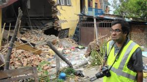 Cal State Fullerton geotechnical engineer Binod Tiwari looks grim as he surveys the damage around the Katmandu Valley after Nepal's April 25 quake. (Molly Hennessy-Fiske / Los Angeles Times)