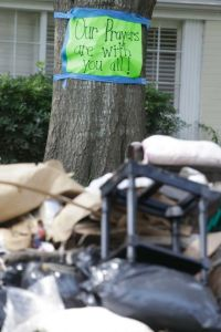 A sign of support is posted near flood debris at a home by North Braeswood Boulevard.   Photo: Melissa Phillip, Staff