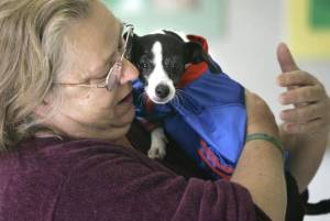 Nancy Hicks of New Orleans is reunited with her dog Precious at the Erie County SPCA in New York in October 2005 after being separated during Hurricane Katrina.  DAVID DUPREY  - Associated Press file