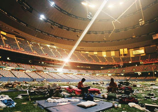 Stranded victims of Hurricane Katrina rest inside the Superdome, which became a makeshift shelter from the storm, on Sept. 2, 2005 in New Orleans. Photos by Mario Tama/Getty Images