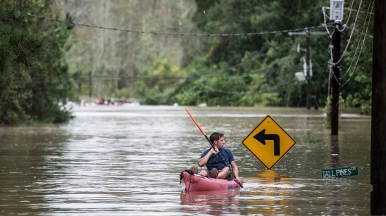 A man kayaks on Tall Pines Circle in Columbia, S.C. on Oct. 4.