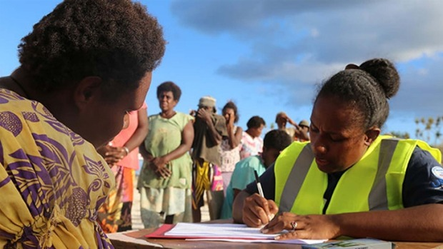 Red Cross volunteers in Vanuatu assess people's needs after cyclone Pam in March.  Photo: IFRC