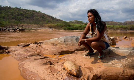 The toxic mud has polluted the Rio Doce (Portuguese for 'sweet river') used by indigenous people, such as Fabiana Rothy, from Brazilia's Krenak tribe, to fish and celebrate religious ceremonies. Photograph: Heriberto Araújo for the Guardian