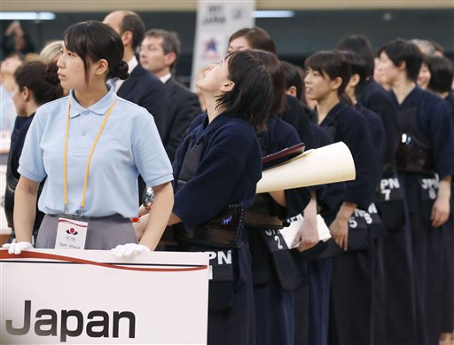 A Japanese kendo player looks up the ceiling as a strong earthquake jolts Nippon Budokan martial arts hall during an awarding ceremony for the World Kendo Championships in Tokyo Saturday, May 30, 2015. A powerful and extremely deep earthquake struck a group of remote Japanese islands and shook Tokyo on Saturday, but officials said there was no danger of a tsunami, and no injuries or damage were immediately reported. (Meika Fujio/Kyodo News via AP)