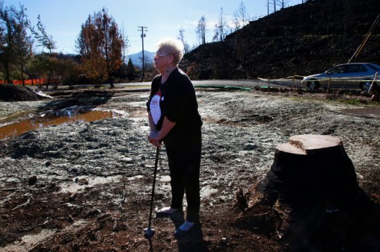 Darlene Simmons on the lot where her house stood before it burned to the ground. Credit Jim Wilson/The New York Times