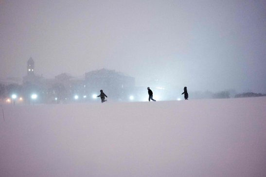People play in the snow on the National Mall in Washington Photograph: Brendan Smialowski/AFP/Getty Images