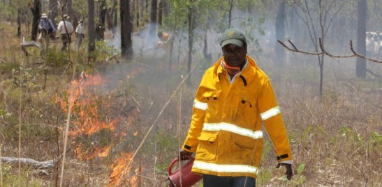 An undated supplied photo released Thursday, Sept. 24, 2009 of Marcus Cameron of Manwurrk Rangers laying a fire break for traditional management of country in the Djelk and Warddeken Indigenous Protected Areas. The Australian Federal Government and traditional landowners signed the first of two agreements today establishing two immense and globally significant conservation reserves on indigenous lands located in Western and Central Arnhem Land spanning over two million hectares (20,432 square kilometres). (AAP Image/Peter Eve) NO ARCHIVING, EDITORIAL USE ONLY