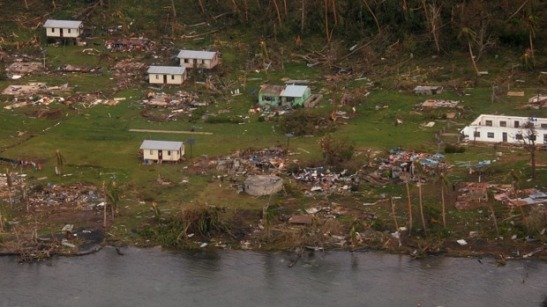 Debris is scattered around damaged buildings at Muamua on Vanua Blava Island in Fiji, after Cyclone Winston tore through the island nation. Photo: NZ Defence/AP