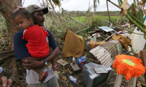 A Fijian resident looks at the damage caused by Cyclone Winston . Photograph: AFP/Getty Images
