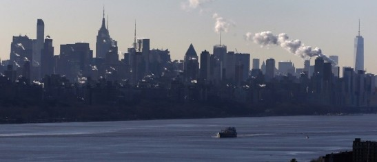 Image: A ship travels north on the Hudson river past the Manhattan borough of New York City. REUTERS/Mike Segar.