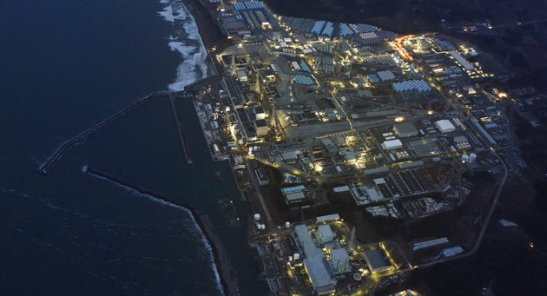 Tokyo Electric Power Co.'s (TEPCO) tsunami-crippled Fukushima Daiichi nuclear power plant is illuminated for decommissioning operation in the dusk in Okuma town, Fukushima prefecture, Japan, in this aerial view photo taken by Kyodo March 10, 2016, a day before the five-year anniversary of the March 11, 2011 earthquake and tsunami disaster. Mandatory credit REUTERS/Kyodo  ATTENTION EDITORS - FOR EDITORIAL USE ONLY. NOT FOR SALE FOR MARKETING OR ADVERTISING CAMPAIGNS. MANDATORY CREDIT. JAPAN OUT. NO COMMERCIAL OR EDITORIAL SALES IN JAPAN.  THIS IMAGE WAS PROCESSED BY REUTERS TO ENHANCE QUALITY, AN UNPROCESSED VERSION WILL BE PROVIDED SEPARATELY.            TPX IMAGES OF THE DAY