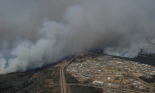 An aerial photo shows wildfires near neighborhoods in Fort McMurray, Alberta, Canada on Wednesday. Photograph: Handout/Reuters