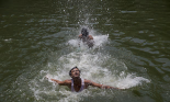 Boys swimming to cool off as record temperatures of 51C were recorded in the Indian city of Phalodi. Photograph: Tsering Topgyal/AP