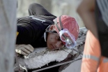 Rescuers search for victims buried under the rubble in Pedernales, Ecuador on April 19, 2016. At least 413 people were killed when a powerful earthquake struck Ecuador on Saturday, destroying buildings and a bridge and sending terrified residents scrambling from their homes, authorities said Sunday. / AFP / RODRIGO BUENDIA        (Photo credit should read RODRIGO BUENDIA/AFP/Getty Images)