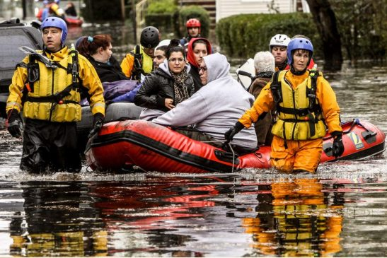 People are evacuated from a neighborhood in Little Ferry, New Jersey, one day after Hurricane Sandy slammed the East Coast on October 30, 2012. The death toll from superstorm Sandy has risen to 32 in the United States and Canada, and was expected to climb further as several people remained missing, officials said. Officials in the states of Connecticut, Maryland, New York, New Jersey, North Carolina, Pennsylvania, Virginia and West Virginia all reported deaths from the massive storm system, while Toronto police said a Canadian woman was killed by flying debris. AFP PHOTO/Mehdi Taamallah (Photo credit should read MEHDI TAAMALLAH/AFP/Getty Images)