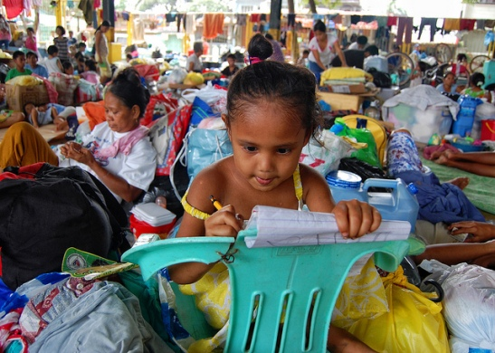 Young girl in an evacuation center, 2009. Philippines. Photo: Jerome Ascano / World Bank Source: http://blogs.worldbank.org/voices/investing-pre-crisis-financial-risk-management-eases-post-disaster-recovery-needs