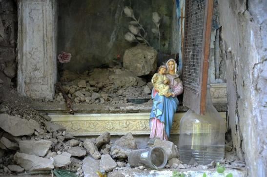 A Virgin Mary statue stands debris ruins in the Italian central town of Pescara del Tronto, on August 24, 2016 after a powerful earthquake rocked central Italy. (Credit: Marco Zeppetella/AFP/Getty Images)