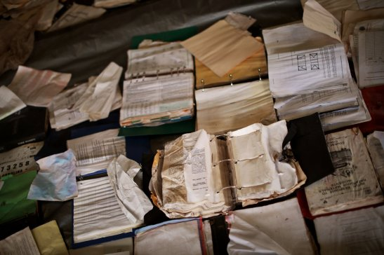 Books and papers drying in the Princeville Fire Department's former garage. Credit Travis Dove for The New York Times