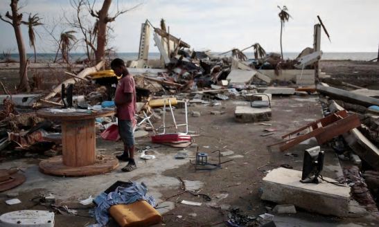 A boy plays in a building destroyed by hurricane Matthew in Coteaux, Haiti. Photograph: Andres Martinez Casares/Reuters